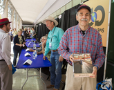 """Author Bob """"Boze"""" Bell (background) and Russ Luke at the Integrated Learning Center author signing area. While seeking Bell's autograph, Luke discovered they had grown up in the same town of Kingman, Arizona."""