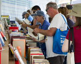 Shoppers in the Friends of Pima County Public Library tent.