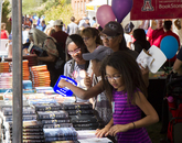 Attendees shop in the UA BookStores tent.