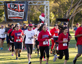 Fans of the UA and ASU football teams show their support at a 5K run. UA supporters made a stronger showing than their ASU counterparts.