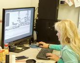 UA graphic artist Jennie Norris works on renderings of the memorial.