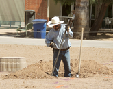 Sergio Gonzales digs as part of the USS Arizona Mall Memorial's construction.