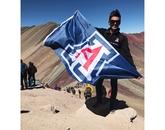 "In the winning School Spirit photo, ""U of A at Rainbow Mountain,"" Carlos Santoscoy, a senior public health major, displays Wildcat pride during the Accelerated Public Health in Cusco program."