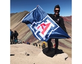 "In the winning School Spirit photo, ""U of A at Rainbow Mountain,"" Carlos Santoscoy, a senior public health major, displays Wildcat pride during the Accelerated Public Health in Cusco program."