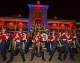 Old Main, lit in red and blue for the occasion, provided a special backdrop for the marching band on Friday night.