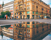 "Hunter Weiss, a junior studying business, calls this ""the best picture he has ever taken."" The image of a building is perfectly reflected in a puddle during the CEA Prague program."