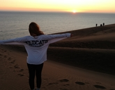 Rachel Christensen, who is studying economics and Spanish, takes in a sunset on the coast of Chile.