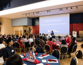 Melinda Burke, president of the UA Alumni Association, speaks during the dinner and networking event.