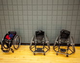 Standard and specially designed wheelchairs are used for athletics.