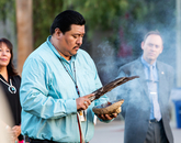 Flores presides over the ceremony as the UA's Karen Francis-Begay, assistant vice president for tribal relations, and Shane Burgess, dean of the College of Agriculture and Life Sciences, look on.