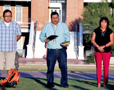 Miguel Flores is flanked by Donovan Pete, a master's degree student in library and information sciences, and Karen Francis-Begay.