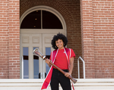 Shelby Young, a senior graduating with degrees in Africana studies and microbiology, poses with the university's ceremonial mace during filming for the virtual 2020 Commencement. (Photo: Chris Richards/University of Arizona)