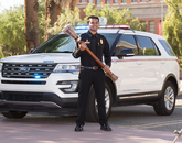Abhijay Murugesan, a senior graduating with a degree in public health and the chief and executive director of the university's student Emergency Medical Service team, poses with the university's ceremonial mace during filming for the virtual 2020 Commencement. (Photo: Chris Richards/University of Arizona)