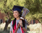 An Luu, a senior graduating with a degree in physiology, poses with the university's ceremonial mace during filming for the virtual 2020 Commencement. (Photo: Chris Richards/University of Arizona)