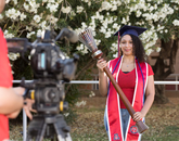 Jaesa Strong, a senior graduating with a degree in pharmacy, poses with the university's ceremonial mace during filming for the virtual 2020 Commencement. (Photo: Chris Richards/University of Arizona)