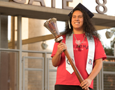 Tony Viola IV, a senior graduating with a degree in literacy, learning and leadership, poses with the university's ceremonial mace during filming for the virtual 2020 Commencement. Viola is one of this year's Robie Gold Medal recipients. (Photo: Chris Richards/University of Arizona)