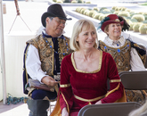Jane Prescott-Smith, special assistant to the dean with University Libraries and one of those who helped get the First Folio to the UA, sits with members of the Renaissance Festival, who later led workshops on improv comedy, sing-along songs and Shakespeare trivia.