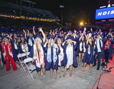 The screen calls for noise, and this merry group of graduates supplies some added volume at Commencement. (Photo: John de Dios/UANews)