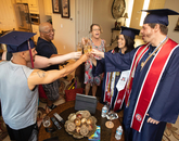 Lauren Easter (second from right), this year's Provost Award winner, celebrates with her partner and fellow graduate Zachary Stout (right) and family and friends. (Photo: Chris Richards/University of Arizona)