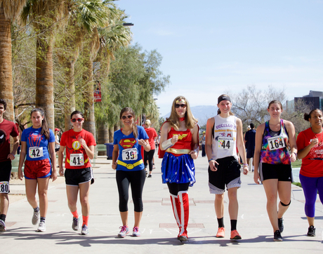 UA Faculty Fellows and students organized a superheroes-themed fun run to raise money for families whose children have cancer.
