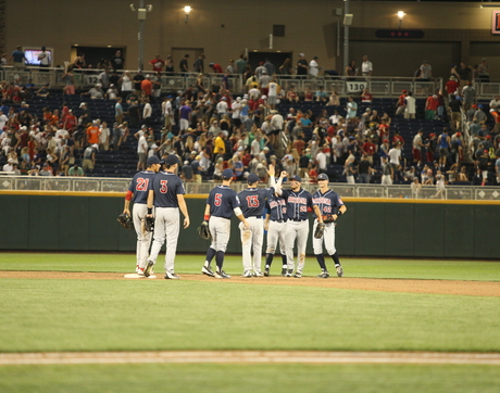 The Arizona Wildcats celebrate Saturday night's win over Miami (Fla.) in the College World Series. (Photo: Stan Liu/Arizona Athletics)