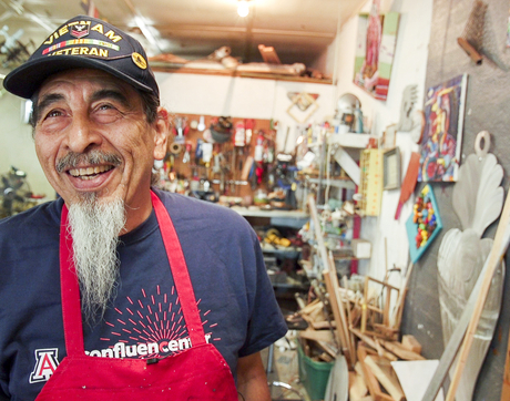 The studio is a happy place for Alfred Quiroz. (Photo: Bob Demers/UANews)