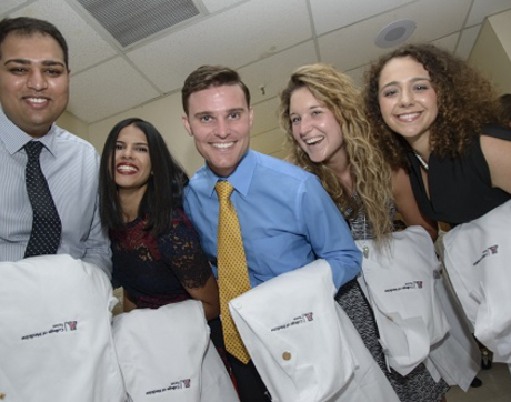 Arif Muhammad, Amisha Singh, Kevin Severson, Jessika Iwanski and Nicole Bejany at the ceremony, which honors new medical students as they accept the responsibility of the doctor-patient relationship. Each student receives a acoat and a stethoscope, thanks to UA College of Medicine – Tucson alumni, faculty and friends. (Photo credit: Mark Thaler/UAHS BioCommunications)