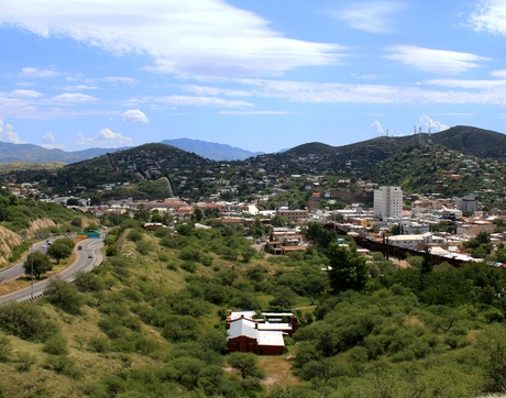 At the southernmost part of the Canamex Corridor sits the border community of Ambos Nogales in Arizona and Sonora, Mexico. A rust-colored steel barrier divides the two cities. (Photo: Amanda Oien)