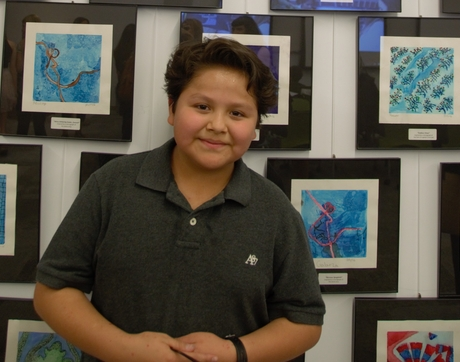 "Mansfeld Middle School student Antonio Diaz created his painting, ""Red Hot Wood Chips,"" after studying micrograph images in class. (Photo: Edwin Arnaud)"