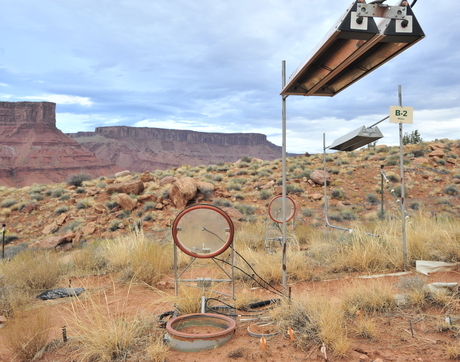 A climate manipulation study site near Moab, Utah, where the albedo measurements were made. The study areas are warmed using infrared lamps hanging above. Also pictured is a carbon dioxide soil respiration chamber placed in the study area to understand the carbon balance of biocrusts. (Photo: Austin Rutherford)