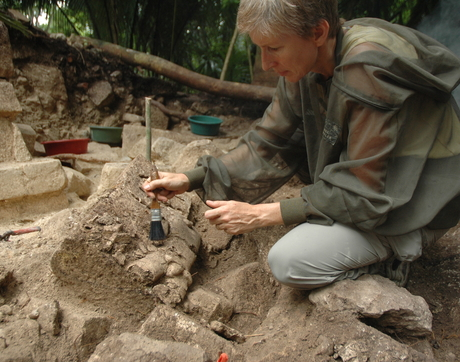 UA anthropology professor Daniela Triadan excavates the collapsed facade of the royal palace of Ceibal, which was burned during the Classic Maya collapse in the ninth century. (Photo: Takeshi Inomata)