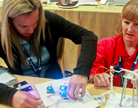 High school teachers grapple with NeuroBytes, which they can use to teach their students about neural pathways.