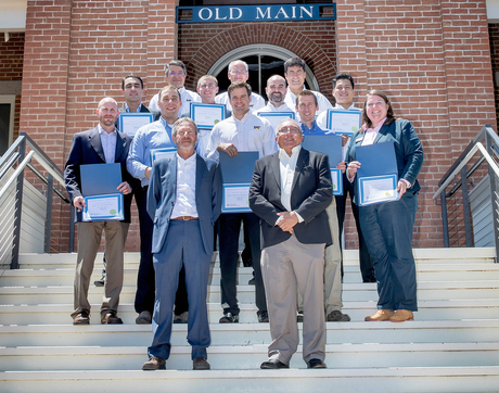 John Kemeny (front row, left), chair of the UA Department of Mining and Geological Engineering, and Victor Tenorio (front row, right), MGE professor of practice, with the inaugural class of 12 graduates of the Mining 360 Program. (Photo: John de Dios/UANews)