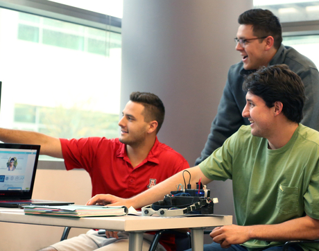 Optical engineering major Brian Herrera (right) works with two of his McGuire program teammates, systems engineering major Clayton Jeanette (left) and marketing major Zachary Kane on the website they are creating for their new-venture concept: a wearable 3-D camera. (Photo: Sarah Mauet)