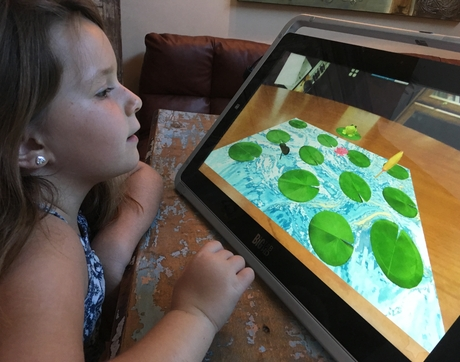 Psychologist Jamie Edgin built a homemade memory test for children that has now been transformed into an Android touchscreen assessment. (Photo courtesy of Jamie Edgin)