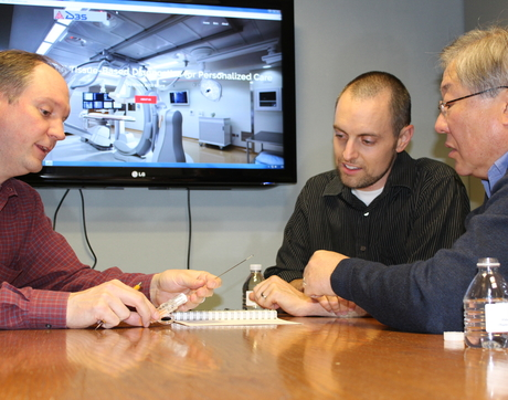 Co-inventors Dr. Charles Hennemeyer (left) and Dr. Michael Larson (center) discuss design ideas with D3S CEO Nick Lim. (Photo: Paul Tumarkin/Tech Launch Arizona)