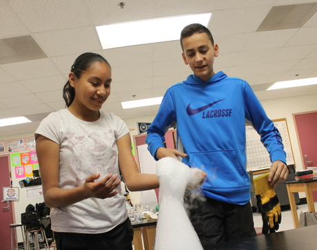 Baboquivari Middle School students Rosalina Mendez, 13, and Brightstar Benson, 13, participate in UA biochemist John Jewett's after-school program, funded by the NSF. (Photo: Emily Litvack/Office for Research & Discovery)