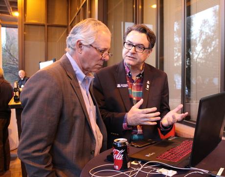 UA President Robert C. Robbins (left) talks with professor Moe Momayez about the mining sensor network Momayez developed and is bringing to market via the startup Guia. (Photo: Paul Tumarkin/Tech Launch Arizona)