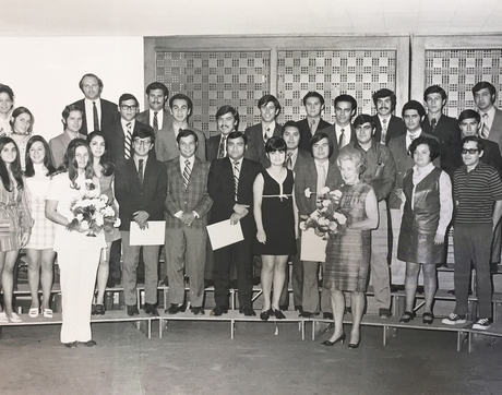 CESL's inaugural final ceremony for its Intensive English Program with a group of engineers from Mexico in 1970, with CESL advisor Helen Abdulaziz (left) and the center's first director, Ernestine Neff (right), holding flowers