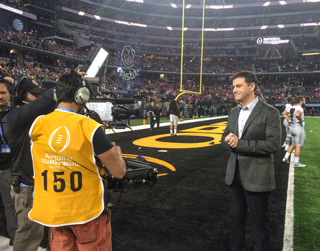 UA alumnus Randy French (obscured behind vest) gets Jimmy Kimmel into the shot at college football's national championship game last January in Dallas. (Photo: Ryan Lacher)
