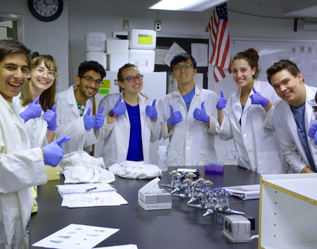 2018 KEYS interns pose with their successful protein gel during biotechnology training. (Photo: Deanna Sanchez)