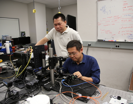 Rongguang Liang (left) of the College of Optical Sciences received funding to develop 3-D printing of freeform optics. He is shown here with graduate student and co-inventor Zhihan Hong. (Photo: Paul Tumarkin/Tech Launch Arizona)