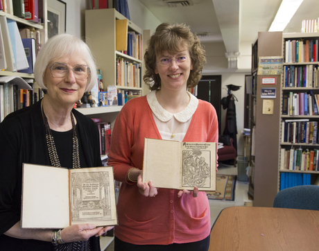 Susan Karant-Nunn and Ute Lotz-Heumann, professors in the UA Division for Late Medieval and Reformation Studies, hold the two new acquisitions to University Libraries' Special Collections purchased by the Laura and Arch Brown Library Endowment. The scholars will speak about the pamphlets as part of the April 11 Early Books Lecture Series. (Photo: Aengus Anderson/Special Collections)