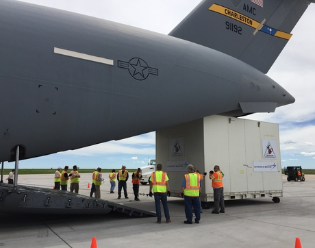 The boxed-up spacecraft for the UA-led OSIRIS-REx asteroid sample return mission is loaded onto a C-17 cargo plane at Buckley Air Force Base in Aurora, Colorado. (Photo: Erin Morton/UA)
