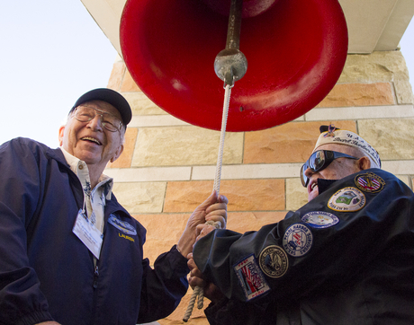 USS Arizona survivors Lauren Bruner (left) and Clarendon Hetrick ring the ship's bell during a visit to the UA campus in December 2015. Hetrick has since died, and Bruner, now 96, is one of only five living survivors from the ship. (Photo: Bob Demers/UANews)