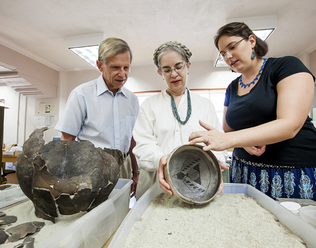 Philip and Kathe Gust with anthropology graduate student Claire Barker at the Homolovi Research Program laboratory (Photo: John de Dios/UANews)