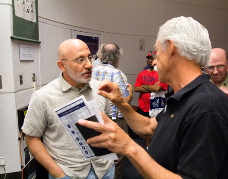 "The UA's Bashar Rizk (left), the lead on the OSIRIS-REx Camera Suite, says, ""We're hoping this asteroid will surprise us in the way that so many images have in the past."" (Photo: Bob Demers/UANews)"