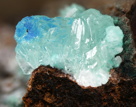 Zinc, chloride, copper, oxygen and water all came together to form this mineral, simonkolleite, on a copper mining artifact in Arizona's Rowley mine. (Credit: RRUFF Project)