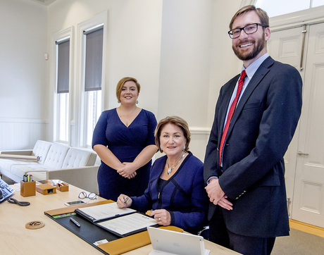 UA President Ann Weaver Hart signs the sustainability agreement with ASUA senator Maddy Bynes (left) and Ben Champion, director of the UA Office of Sustainability, on hand. (Photo: John de Dios/UANews)