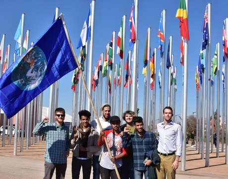 Remy Franklin (right) stands with fellow SustainUS delegates and Moroccan activists outside the United Nations climate talks.